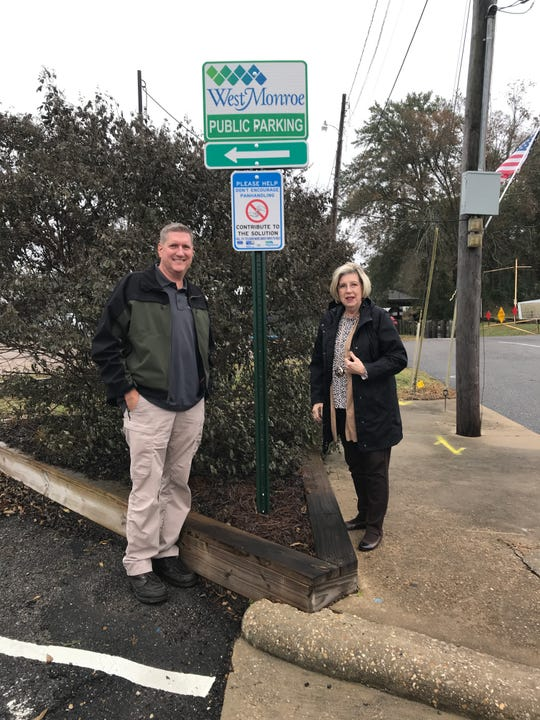 West Monroe Police Chief Jeff Terrell and United Way of Northeast Louisiana President Janet Durden stand by one of the city's new signs discouraging panhandling on Antique Alley in West Monroe on Thursday.