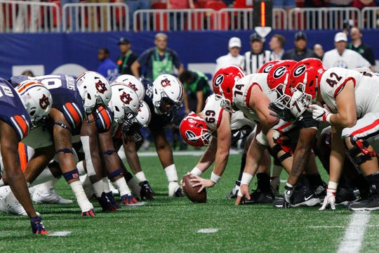 Auburn and Georgia line up against each other during the SEC Championship game in Atlanta on Dec. 2, 2017.