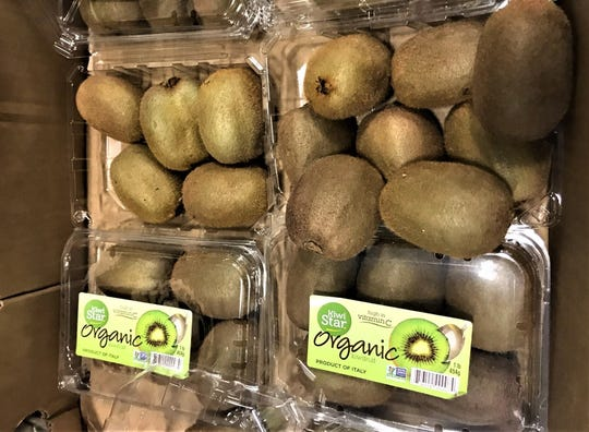Kiwis in a box in the Montgomery Area Food Bank warehouse