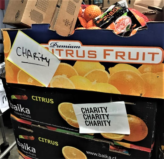 Oranges in a box in Montgomery Area Food Bank pantry