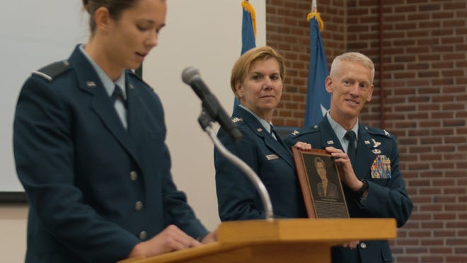 Colonel Christopher Bennett, Headquarters Air Force ROTC commander, presents the Air Force ROTC Distinguished Alumni Award to retired Gen. Lori Robinson during a ceremony at AFROTC Detachment 475, University of New Hampshire, Nov. 12, 2019.