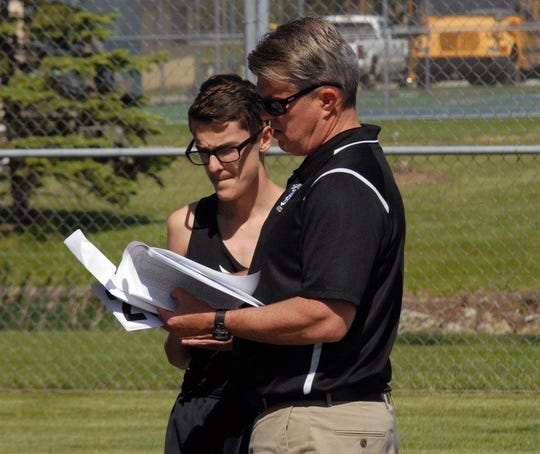 Former Daleville cross county coach David Beard talks with a runner during a meet. Beard retired after coaching cross country for 32 years at Daleville High School.