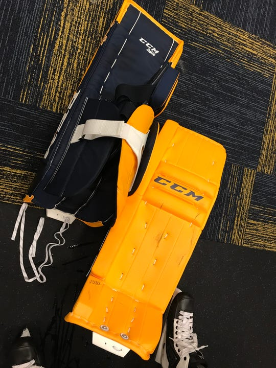 Predators goalie Juuse Saros' new gold and navy blue pads