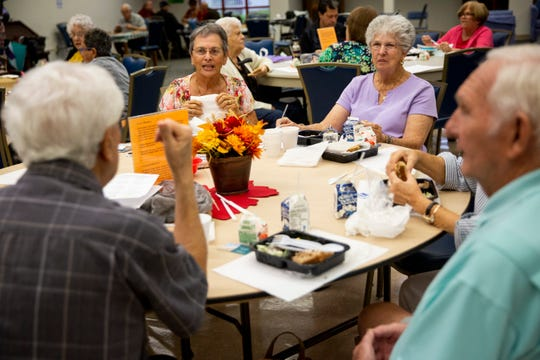 From left to right, Rev. Anthony Planes, Linda Sylvia, Marie Freeman, and John Vacha talk as they eat their meals during a free hot lunch program at Golden Gate Senior Center on Friday, November 15, 2019. The center not only provides meals for its members, but it gives them opportunities for socialization.