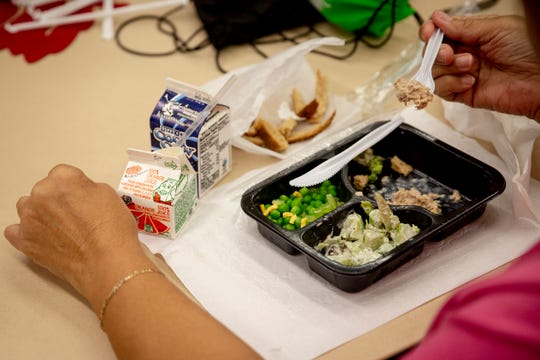 Mirian Fall eats her meal during a free hot lunch program at Golden Gate Senior Center on Friday, November 15, 2019.
