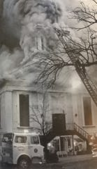 Firefighters are seeing combating the Granville Opera House fire in 1982.