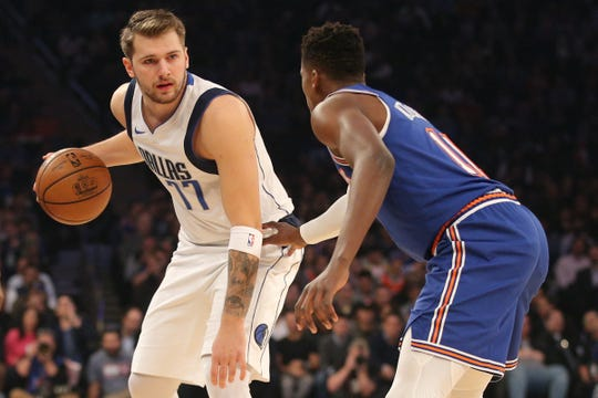 Nov 14, 2019; New York, NY, USA; Dallas Mavericks shooting guard Luka Doncic (77) controls the ball against New York Knicks point guard Frank Ntilikina (11) during the first quarter at Madison Square Garden.
