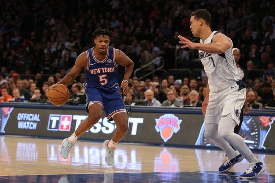 Nov 14, 2019; New York, NY, USA; New York Knicks point guard Dennis Smith Jr. (5) controls the ball against Dallas Mavericks power forward Dwight Powell (7) during the third quarter at Madison Square Garden. Mandatory Credit: Brad Penner-USA TODAY Sports
