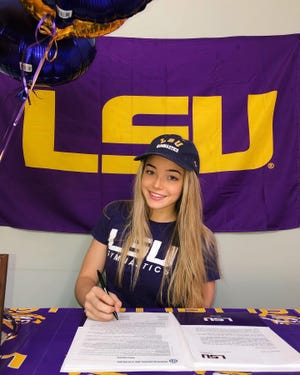 LSU sophomore All-American gymnast Olivia Dunne, shown here when she signed with LSU while in high school in Hillsdale, New Jersey, is expected to profit from a proposed new law in Louisiana that would allow athletes to profit from their name, image and likeness.