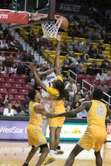 C. J. Bobbitt tries to tip one in for the Aggies. New Mexico State Aggies played the Southern University Jaguars on November 14, 2019.