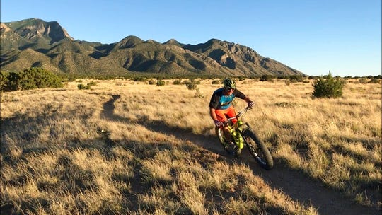 This July 8, 2019 image shows a mountain biker riding the singletrack trail on national forest land in Placitas, New Mexico. Officials say the outdoor recreation industry already brings billions of dollars to the state's coffers but there's room to grow.