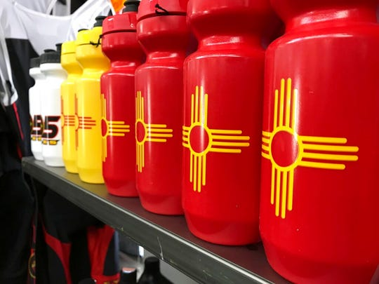 This April 26, 2018 image shows a row of New Mexico-themed water bottles at 505 Cycles in Farmington, New Mexico. The store was among those highlighted by New Mexico Outdoor Recreation Director Axie Navas as she testified Thursday, Nov. 14, 2019, before a panel of lawmakers about the economic impacts of the outdoor recreation industry.
