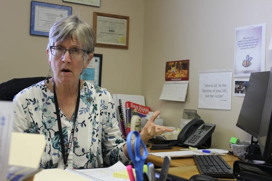 Su Hodgman talks while sitting at her desk in the San Juan County Water Commission building.