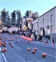 In a new event last year, a pumpkin roll down one of the mountain village's popular streets raised money for the Ruidoso Midtown Association.