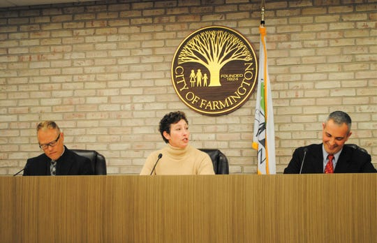 From left, Farmington Councilman Steve Schneemann, Mayor Sara Bowman and Mayor Pro Tem Joe LaRussa participate in their first council meeting following November elections.