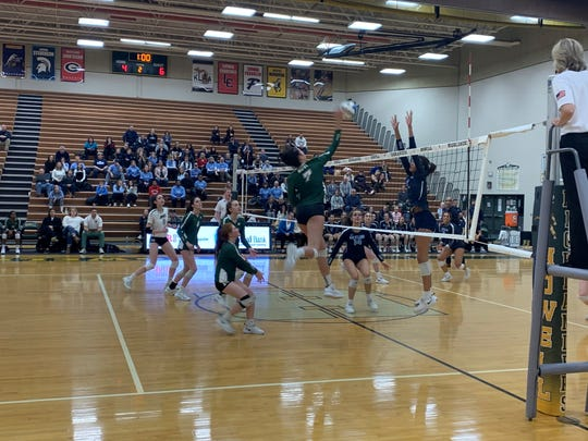 Novi junior Caleigh Robinson goes for a kill against Ann Arbor Skyline in the regional final on Nov. 14, 2019.
