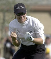 Annika Sorenstam celebrates holing a bunker shot on the last hole of the second day of the 2003 Skins Game, giving her the lead over her three male playing partners.