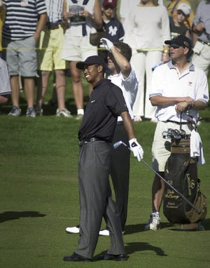 Tiger Woods reacts to hitting his ball up the fairway during the Skins Game 2001 Pro-Am at the Landmark Golf Club in Indio.