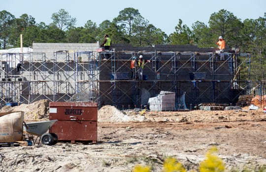 Construction continues Friday on the new school on Elkhart Drive in Navarre. The Santa Rosa County School District hopes to build at least four more schools throughout the county within the next 10 years.