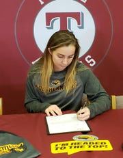 Ryleigh Cawby signs with Southern Miss at Tate on Friday.