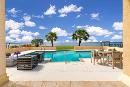 Relax on the waterfront pool deck.