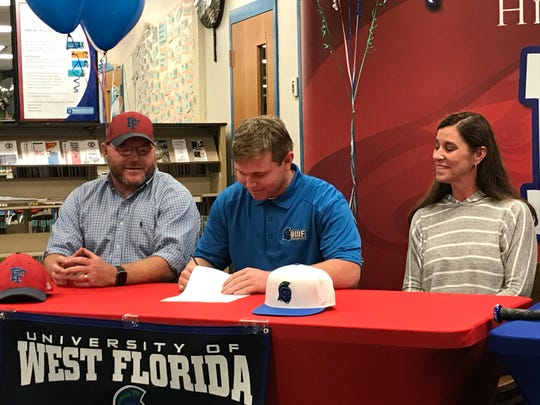 Jason Roberts signs with UWF on Thursday at Pine Forest.
