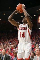 Nov 14, 2019; Tucson, AZ, USA; Arizona Wildcats guard Devonaire Doutrive (14) shoots against the San Jose State Spartans during the second half at McKale Center. Mandatory Credit: Jacob Snow-USA TODAY Sports