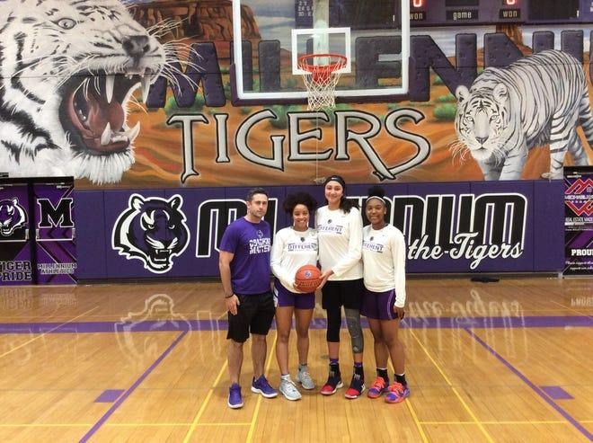 Millennium girls basketball team's Courtland Rojeck, Jasmine Singleton, Ali Zelaya and Trayanna Crisp (left to right).
