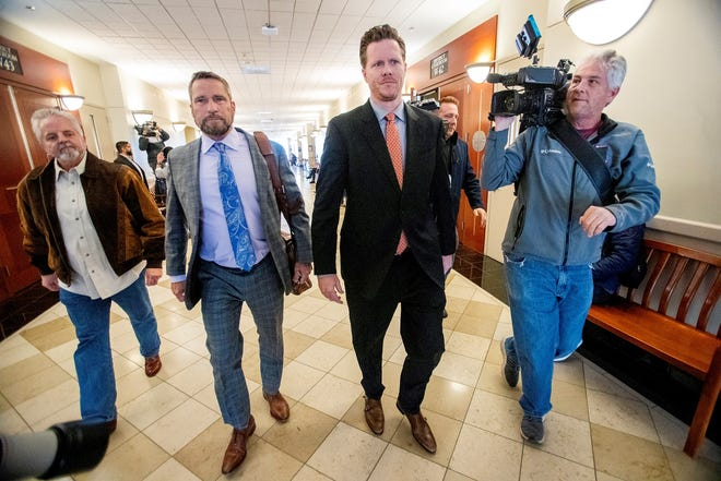 Maricopa County Assessor Paul Petersen leaves the Matheson courthouse in Salt Lake City with his attorney Scott Williams and another unidentified man on Nov. 15, 2019.