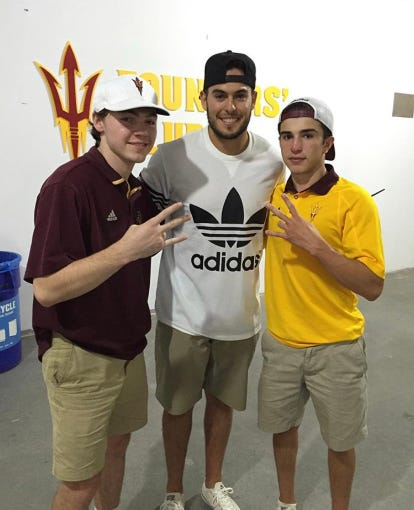Ivan Aguirre (left) poses for a photo with  Mike Bercovici and Trey Hobbs.
