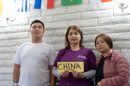 Volunteer members help asylum seekers Zhu Yanying, 41, and her son Zou Ling Jie, 17, from China. They were released by ICE at Iglesia Cristiana El Buen Pastor Church in Mesa, Arizona. Co-pastor Cecilia Ramirez, arranged for food, shelter and their final destination.