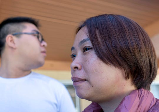 Volunteer members help asylum seekers Zhu Yanying, 41, and her son Ling Jie Zoel, 17, from China. They were released by ICE at Iglesia Cristiana El Buen Pastor Church in Mesa, Arizona.