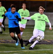 Ben Bullen of York Catholic, right, kicks the ball away from Dallastown's Gabe Wunderlich during the York-Adams League Boys' Soccer Senior All Star Game at Red Lion High School on Thursday, Nov. 14. Wunderlich was named the York-Adams Division I Player of the Year, while Bullen earned the same honor in Division III. John A. Pavoncello photo