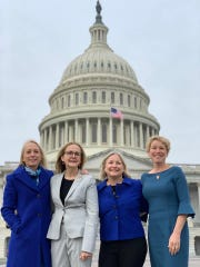 "These four women from Pennsylvania were elected to Congress in 2018 during the Pink Wave. This marks the first time the state has had four women in the state delegation. They call themselves the ""Fab Four."" From left to right, they are Mary Gay Scanlon, a civil rights lawyer from the Philadelphia area; Madeleine Dean, a former state representative; Susan Wild, a former city solicitor in Allentown; Chrissy Houlahan, a retired chemistry teacher and military veteran."