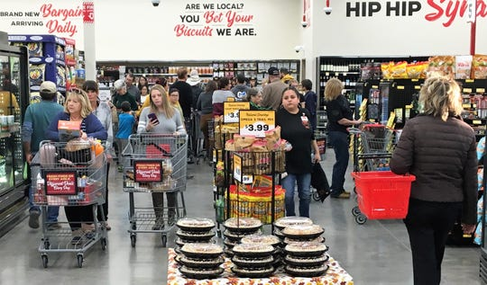 Shoppers crowd the aisles at Grocery Outlet.