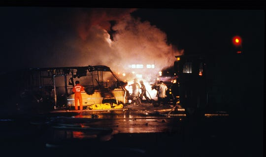 Firefighters battle a fire that started when a Galaxy airplane crashed into motor homes parked  along South Virginia Street killing 70 people and also destroying several motor homes on the ground.  Only one person, George Lamson, a teenager, survived the crash.