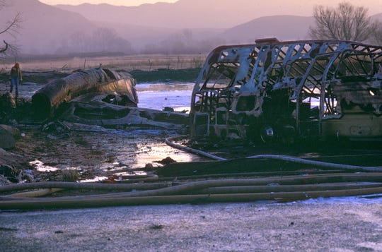 An engine and part of the wing , on the left, was about the largest pieces visible of  the Galaxy airplane after it smashed into  motor homes parked along South Virginia Street south of Del Monte Lane in the early morning hours of Jan. 21, 1985. In this dawn photo the shell of one of the motor homes can also be seen.  A total of 70 people died in the crash.  There was one survivor, a teenager.