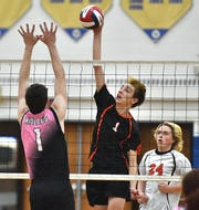 Churchville-Chili's Caleb Smith, right, hits against a block set by Midlakes' Kyle McCann during the Class B regional qualifier played at Webster Schroeder High School, Thursday, Nov. 14, 2019. B1 champion Churchville-Chili advanced to the western regional beating B2 champion Midlakes/Waterloo 3-0 (25-21, 25-23, 25-23).