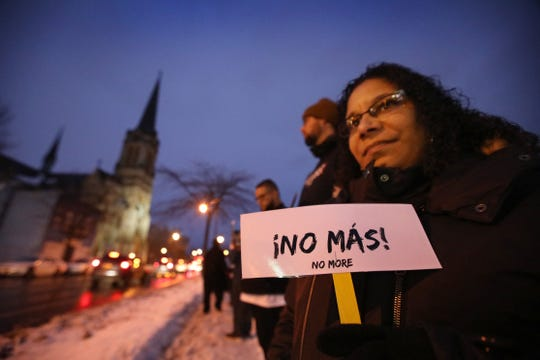 Gildred Aponte, Rochester, holds up a sign to passing traffic that reads  NO MORE! as neighborhood residents and activists make a human chain to disrupt the open-air heroin market and highlight poverty, lack of services, vacant properties and other challenges in northeast, along N. Clinton Ave. near Sullivan Street in Rochester Thursday night, Nov. 14, 2019.