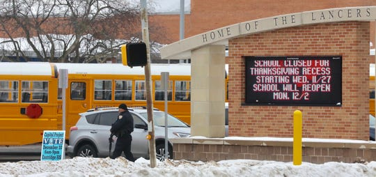 Police in Irondequoit, NY, surround Eastridge High School after a threat to the school in November.