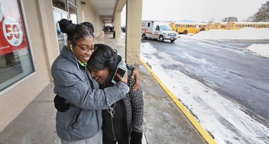 A relieved Margie Lovett-Scott hugs her grand daughter Kadaijah Scott, a senior at Eastridge High, after picking her up at Culver Ridge Plaza after Eastridge High School was evacuated following a bomb threat at the school Friday, Nov. 15, 2019.