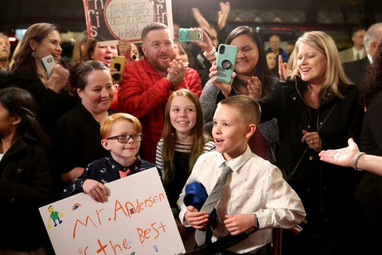Halen Dillon, from left, 8, Madi Dillon, 10, and Cyler Montgomery, 8, watch for their third grade teacher, Christopher Anderson, and Cyler's mom, Carrie Montgomery, both nominees from Hammond Elementary School, on the red carpet before the start of the Crystal Apple Awards at the Elsinore Theater in downtown Salem on Nov. 14, 2019.