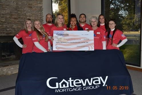 Gateway Mortgage Group of San Angelo presented a check  for $12,470 to Folds of Honor at Bentwood Country Club on Nov. 5.