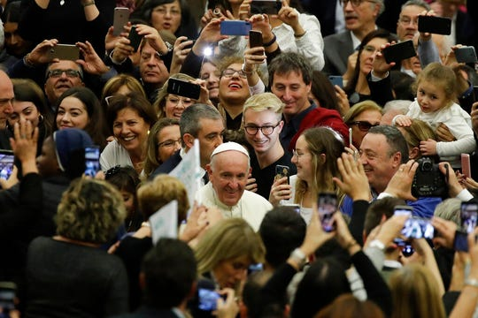 Pope Francis arrives in the Paul VI Hall at the Vatican for an audience with students and teachers of the LUMSA Catholic University, Thursday, Nov. 14, 2019.