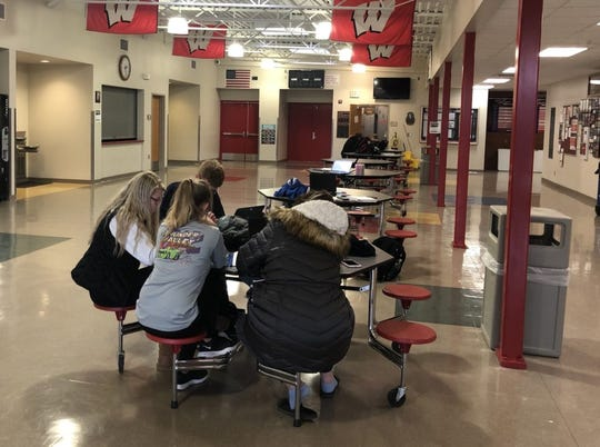 Students hang out quietly in the commons area at Woonsocket High School. Research shows that a lack of funding and resources provided to rural schools can sometimes hamper learning, though testing data shows that small schools sometimes outperform larger districts in South Dakota.