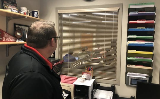 Rod Weber, superintendent of schools in Woonsocket, also serves as principal of the high school and district athletic director. Weber also enables a teacher to have more classroom time by agreeing to monitor an afternoon study hall by watching students through his office window.