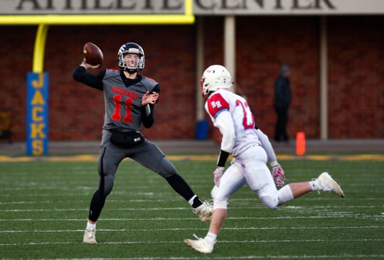 Viborg-Hurley quarterback Chase Mason throws a pass in the Class 9AA state football finals on Thursday, Nov. 14, at the Dana J. Dykehouse Stadium in Brookings.