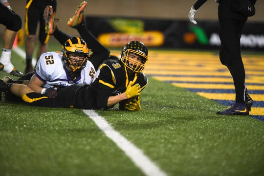 A touchdown made by Colman-Egan's Chase Hemmer (3) is called into question in the Class 9B state championship against Herreid/Selby Area on Thursday, Nov. 14, 2019, at Dana J. Dykhouse Stadium in Brookings, S.D.