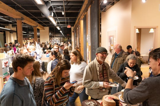 A photo of guests at the 10-year anniversary of Ipso Gallery at Fresh Produce.