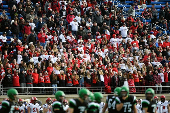 The Brookings Bobcats fans cheer at the Class 11AA state football finals on Friday, Nov. 15, at the Dana J. Dykehouse Stadium in Brookings.